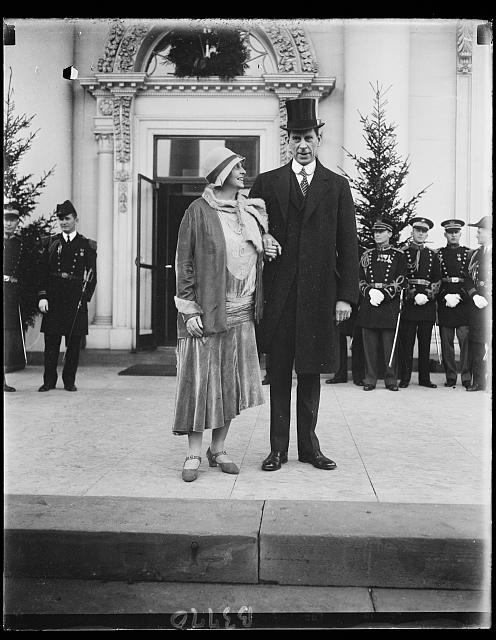 Secretary of the Interior and Mrs. Ray Lyman Wilbur as they appeared at the White House for the New Years reception