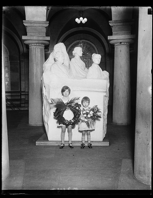 The National Woman's Party today observed the 137th anniversary of the birth of Lucretia Mott, the Quakeress, one of the Equal Rights pioneers. Little Peggy Anthony (left) placed the wreath and at the right is Hope Anthony