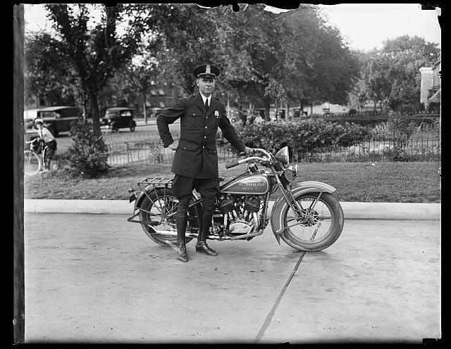 [Metropolitan police officer with motorcycle. Washington, D.C.]