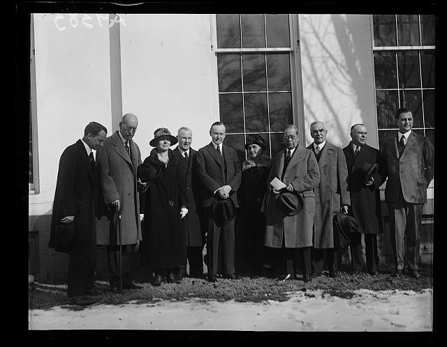 The Associated Chamber of Commerce of [...] Imperial County, California, and the Yuma, Arizona, Chamber [...] Commerce, invited President Coolidge to attend the California [...] Arizona highway celebration to commemorate the completion of [...] last link in the only all the year highway from the Atlantic [...] the Pacific. This event will be held at Yuma, February 28, 1925 [...] In the group, left to right, are: Rep. Philip D. Swing, Senator S. Shortridge, Mrs. R.L. Moyal, Senator Ralph Cameron, President Coolidge, Miss Charlot Hall, Gol. B.F. Fly, Rep. John Raker and Secretary to the President Everett Sanders [White House, Washington, D.C.]