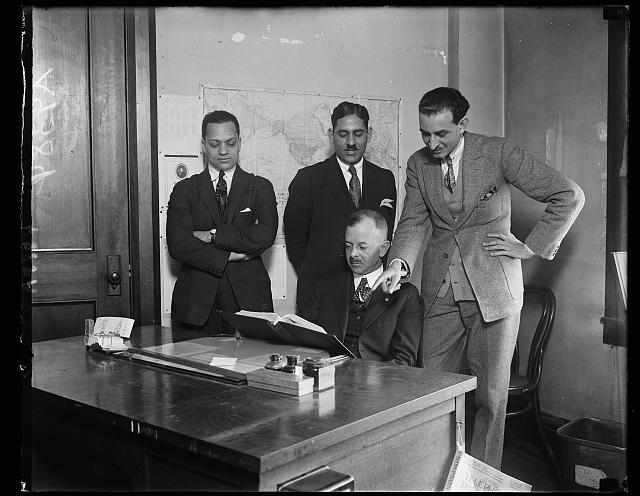Egyptian students to study road building in U.S. Egypt has just sent two of her ablest student[...] the United States to study the American method of road buil[...] under the supervision of the Department of Commerce. In the [...] group, left to right, (standing) Halim Abdelmalek, F.M. Mous [...] Attache of the Egyptian Legation in Washington and M. Hass[...] Dr. James R. Hood, Chief, Levant Section, European Divisio[... Department of Commerce is showing the students pictures of good roads in America