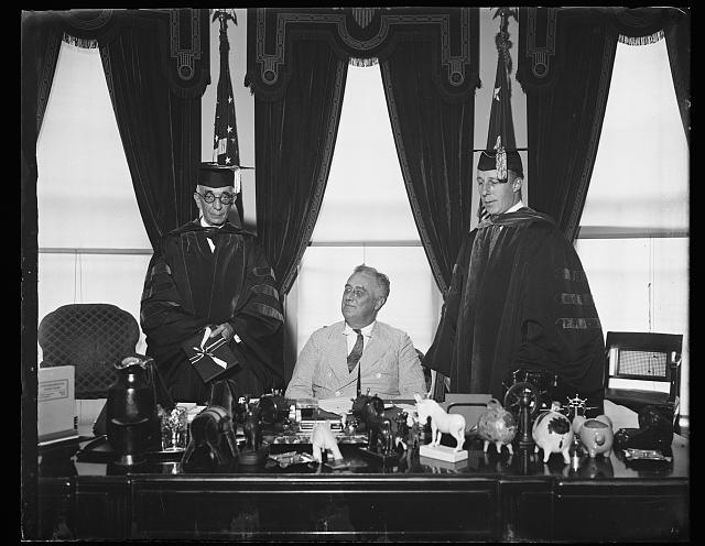 [Franklin D. Roosevelt with] 2 men academic robes