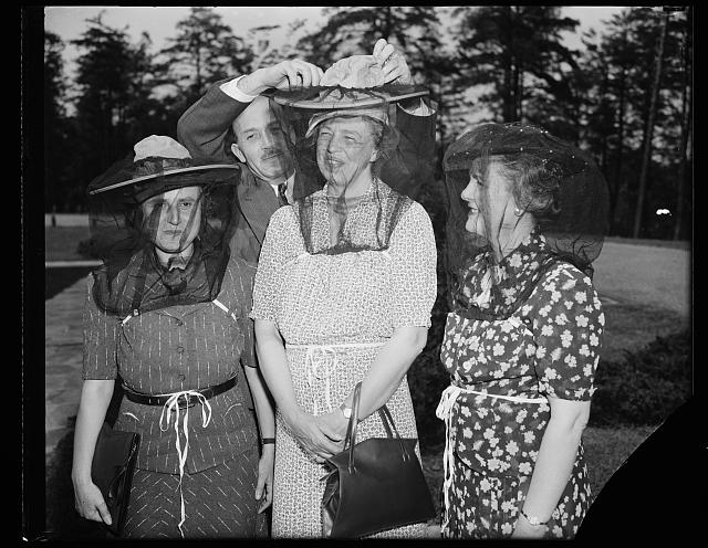 ER [i.e., Eleanor Roosevelt] with 2 women. Big hats