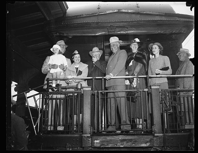 [Group on back of train; includes John Nance Garner, Franklin D. Roosevelt, and Eleanor Roosevelt]