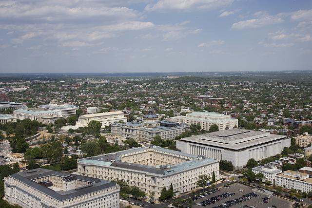 [Aerial view of Capitol Hill featuring the Madison, Jefferson and Adams Buildings of the Library of Congress behind the Cannon House Office Building, Washington, D.C.]