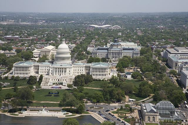 [Aerial view of Capitol Hill featuring the U.S. Capitol, with the Library of Congress Thomas Jefferson Building behind, Washington, D.C.]