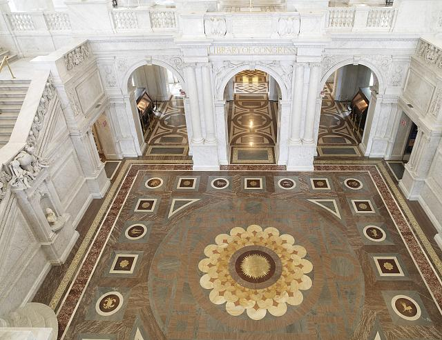 [Great Hall. View from above of zodiac on the floor, three archways, and grand staircase to left. Library of Congress Thomas Jefferson Building, Washington, D.C.]