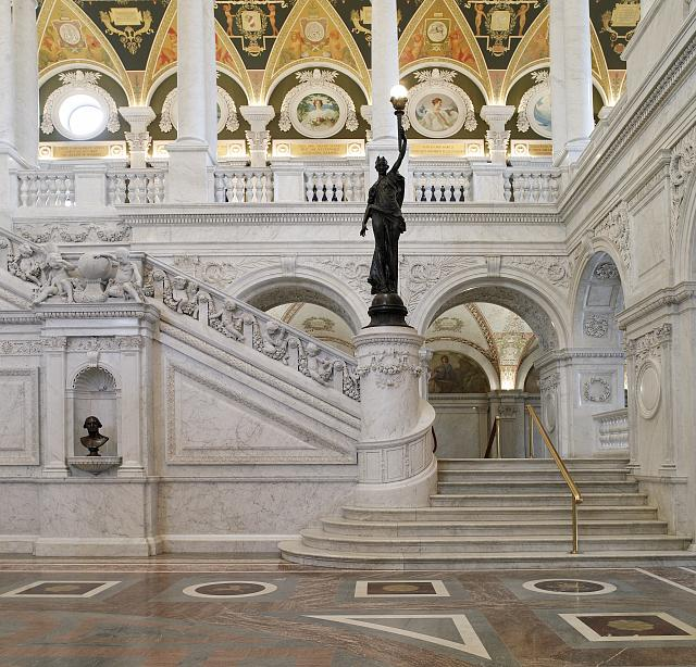 [Great Hall. View of grand staircase and bronze statue of female figure on newel post holding a torch of electric light, with bust of George Washington at left. Library of Congress Thomas Jefferson Building, Washington, D.C.]