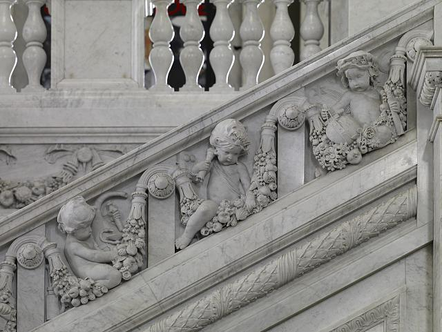 [Great Hall. Detail of putti (physician, electrician, and astronomer) on the grand staircase, Philip Martiny. Library of Congress Thomas Jefferson Building, Washington, D.C.]