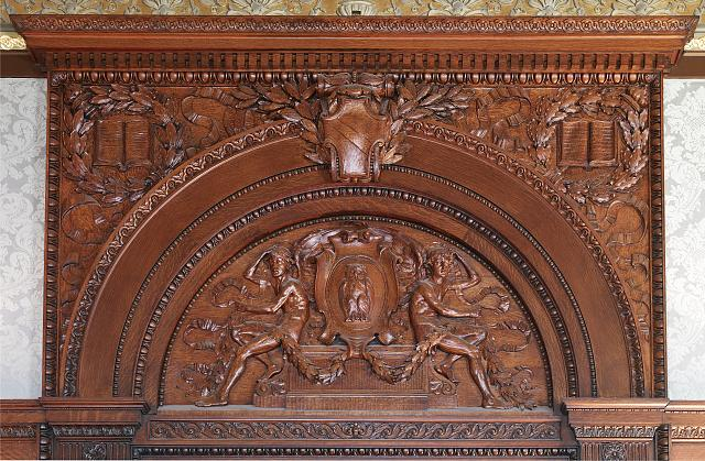 [House Members Room. Oak tympanum above door by Charles H. Niehaus showing a cartouche bearing an owl flanked on either side by seated youths. Library of Congress Thomas Jefferson Building, Washington, D.C.]