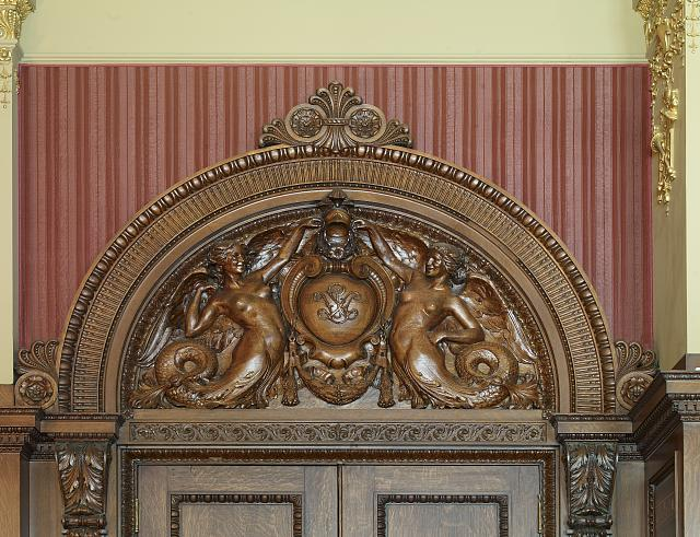 [Senate Members Room. Carved oak tympanum above the doorway by Herbert Adams showing mermaids supporting an American shield. Library of Congress Thomas Jefferson Building, Washington, D.C.]