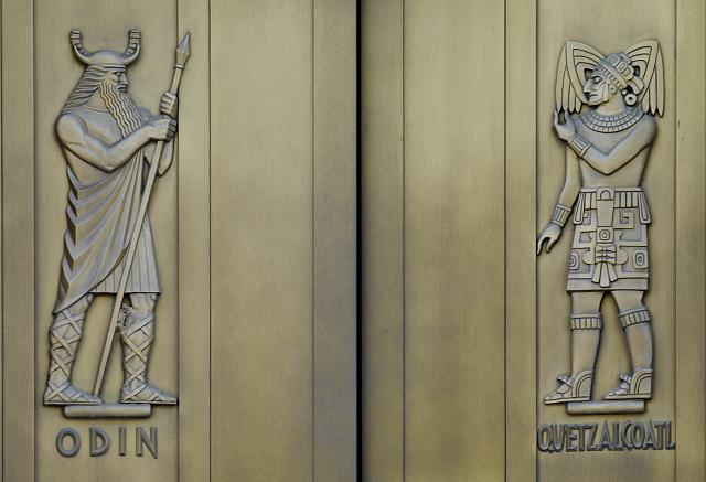 [Exterior view. Door detail, east entrance. Odin and Quetzalcoatl, sculpted bronze figures by Lee Lawrie. Library of Congress John Adams Building, Washington, D.C.]