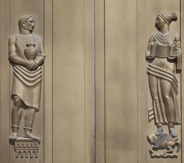[Exterior view. South doors (Independence Avenue) with a sculpted bronze male figure representing physical labor and a female figure representing intellectual labor. Library of Congress John Adams Building, Washington, D.C.]