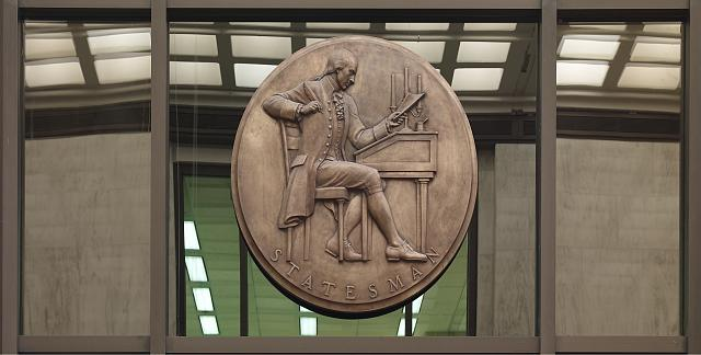 [Entrance Hall. Bronze medallion of James Madison writing at a desk, by Robert Alexander Weinman (above doorway to Manuscript Division). Library of Congress James Madison Building, Washington, D.C.]