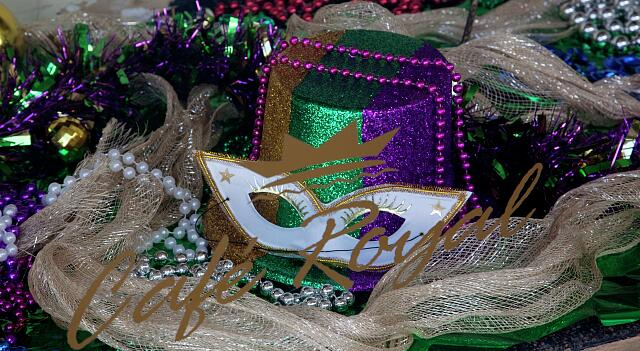 Mardi Gras displays and details in store windows during the Mardi Gras season in Mobile, Alabama