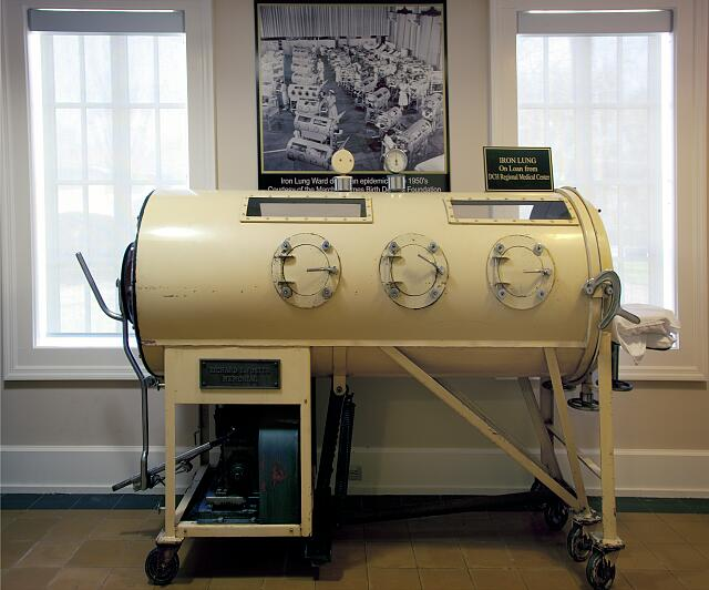 "Iron lung (c. 1933) used to ""breathe"" for polio patients until 1955 when polio vaccine became available is located in the Mobile Medical Museum, Mobile, Alabama"