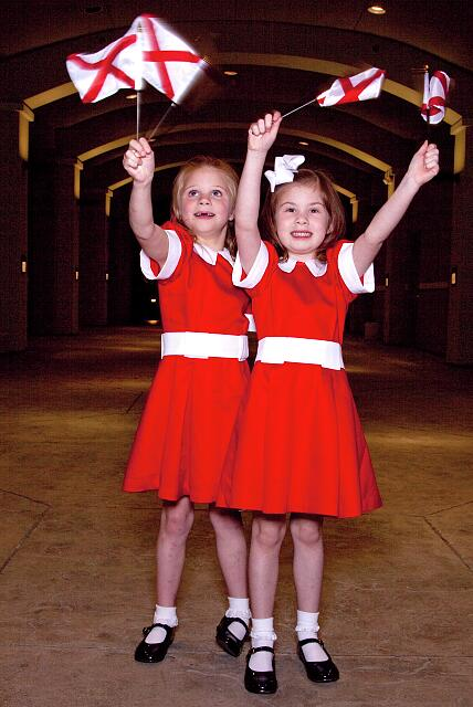 "Lela Davidson and Josie Aronor wave Alabama flags in their red dresses before going off to see the play ""Annie"" in Montgomery, Alabama"