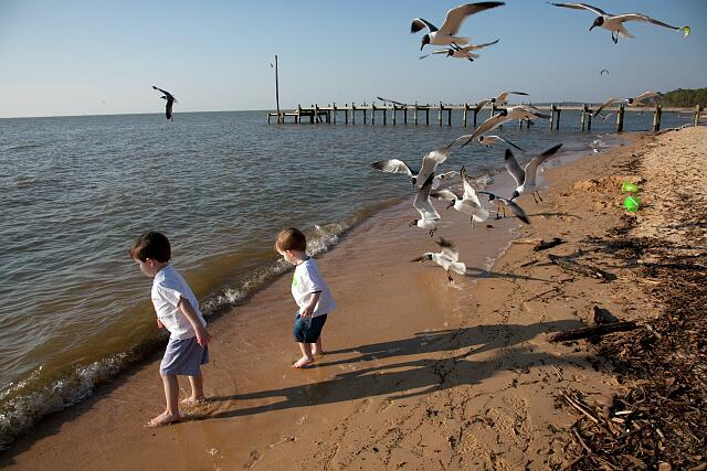 Will and Josh Manning play in the water at Mobile Bay in Fairhope, Alabama