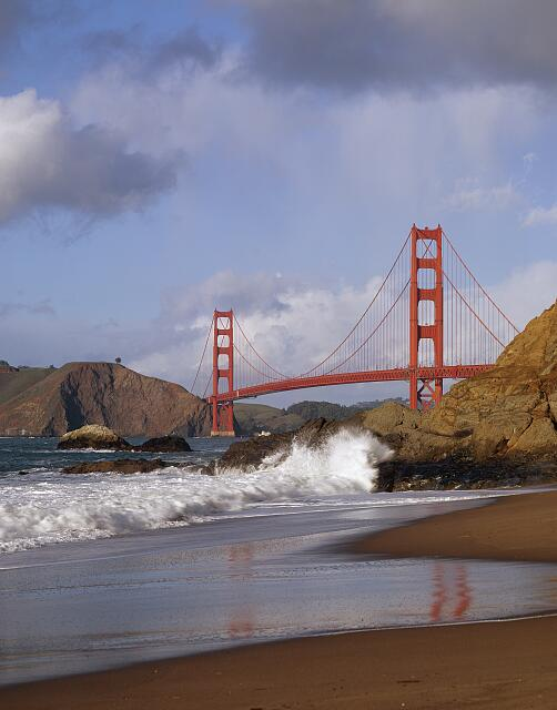 Crashing surf below the Golden Gate Bridge, San Francisco, California