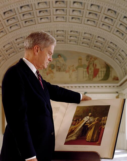 Dr. James Billington, Librarian of Congress, looking at one of the rare books in the Thomas Jefferson Building, Washington, D.C.