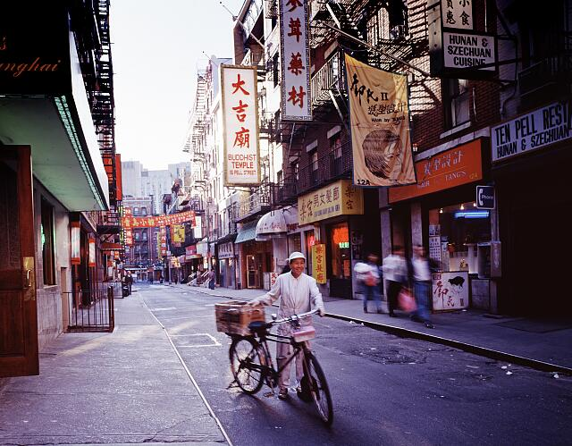 A messenger delivers food to a restaurant in the Chinatown district of New York, New York