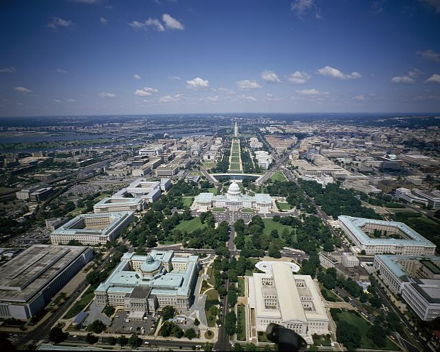 [Aerial view looking west showing Library of Congress Thomas Jefferson Building and James Madison Building, the Supreme Court, and the U.S. Capitol, Washington, D.C.]