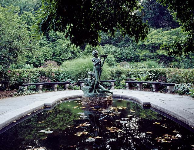 "Statue of Mary and Dickon from Frances Hodgson Burnett's ""The Secret Garden"" at the reflecting pool of the Conservatory Garden in Central Park, New York City"