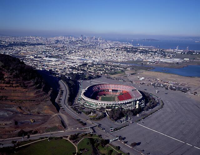 Aerial view of Candlestick Park, home stadium of the San Francisco 49ers National Football League professional team, with downtown San Francisco, California, in the distance
