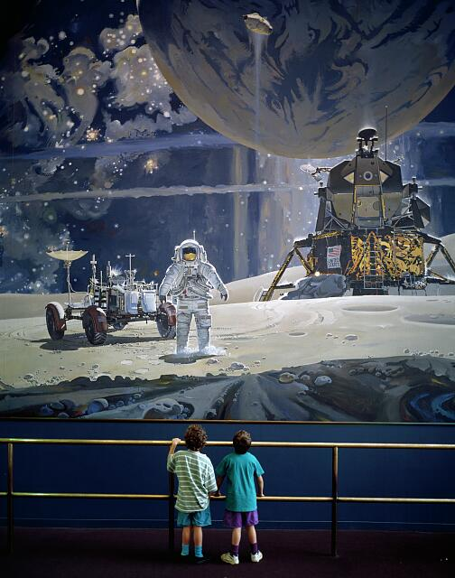 Children stand in wonder at a mural of astronauts at the Smithsonian Institution&#39;s Air and Space Museum in Washington, D.C.