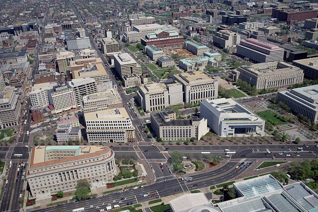 Aerial view of Washington, D.C. The pie-shaped building to the left is the Federal Trade Commission Building, at the apex of the Federal Triangle