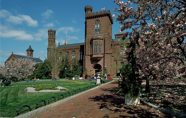 """Springtime view of the Smithsonian Institution """"Castle,"""" the museum complex's first building when it was simply called the """"National Museum."""" Washington, D.C."""