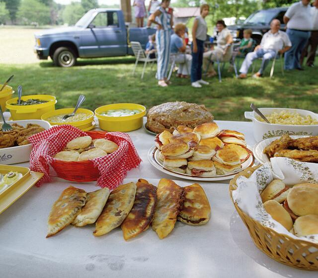 Fried pies, a southern culinary tradition, laid out on a community table at an annual family reunion in North Carolina