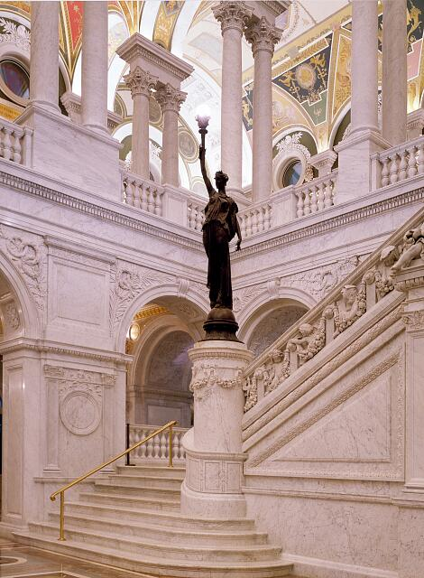 Statue and staircase in the Great Hall of the Library of Congress's Thomas Jefferson Building, Washington, D.C.
