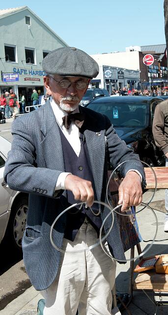Magic tricks are displayed by an artist at Fisherman's Wharf, San Francisco, California