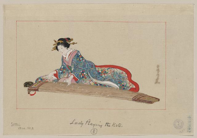 Lady playing the koto