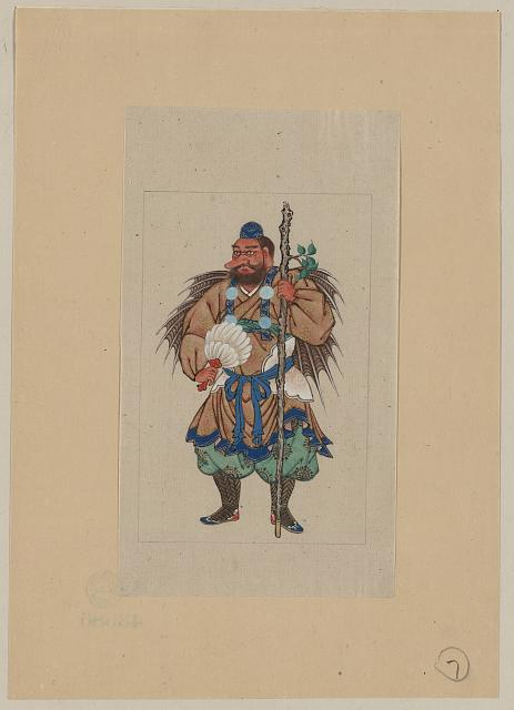 [Man wearing ceremonial costume, carrying a long staff (possibly a small tree trunk sprouting a branch with leaves) and a fan made of feathers; appears to have wings that terminate in sharp points]
