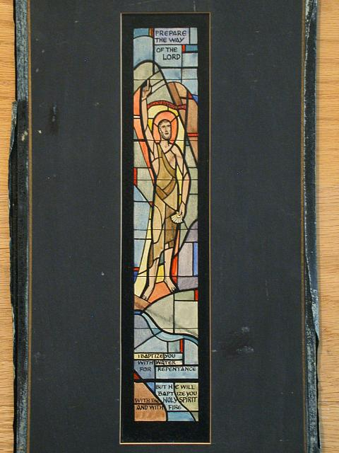 "[Design drawing for stained glass window showing abstracted John the Baptist with shell, and banner ""Ecce Agnus Dei"" (Lamb of God); with text ""Prepare the Way of the Lord"")]"