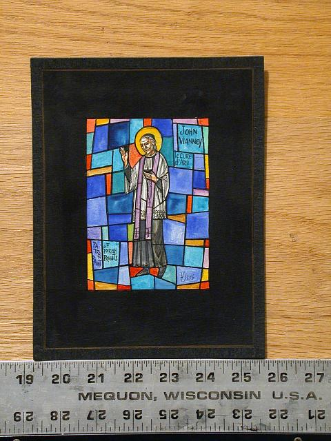 "[Design drawing for stained glass window with text ""John Vianney, le Cure d'Ars, Patron Saint of Parish Priests""]"