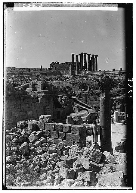 Ruins of Jerash (Gerasa). The cathedral courtyard. Showing the temple of Artemis on horizon