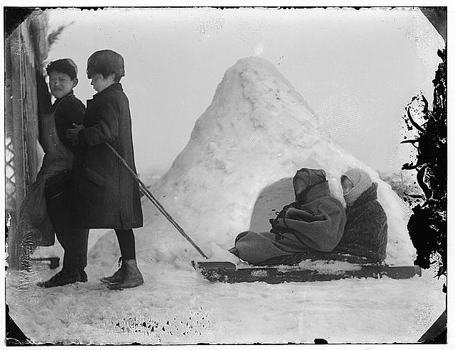 Snow in Jerusalem 1921. Children pulling children on sled