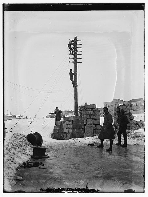 Snow in Jerusalem, 1921. British soldiers putting up electrical lines