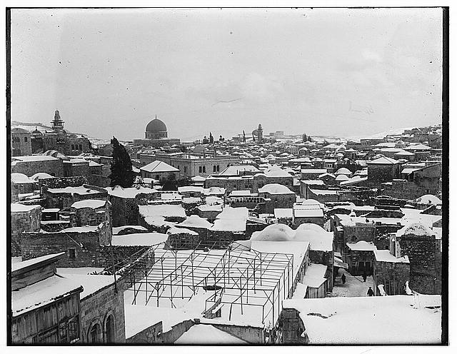 Snow in Jerusalem in 1921. View of roof tops with mosque in the distance