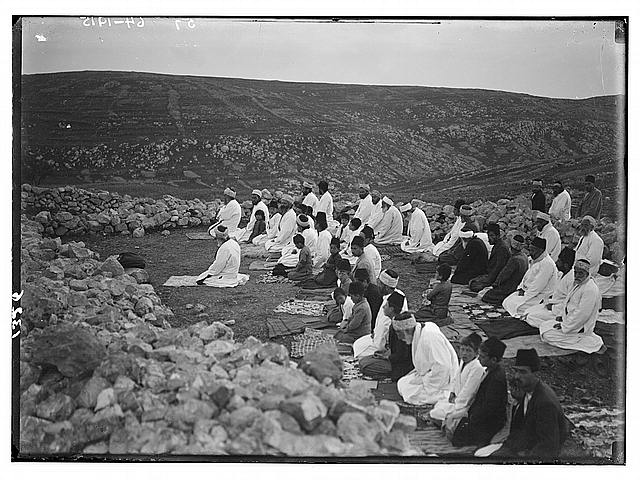 The Samaritan Passover on Mt. Gerizim. Praying on knees.