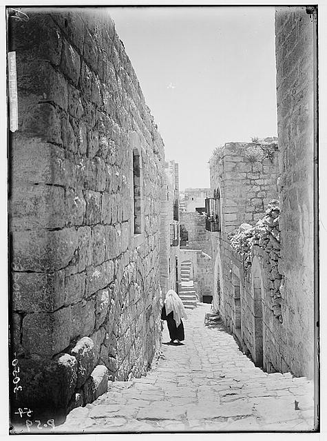 Bethlehem and surroundings. Bethlehem. A sun-lit street. Street of old homes