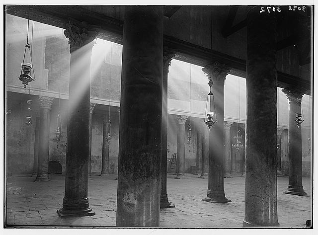 Bethlehem and surroundings. Bethlehem, nave of the Basilica [Church of the Nativity]. Light-shafts encircling the ancient pillars