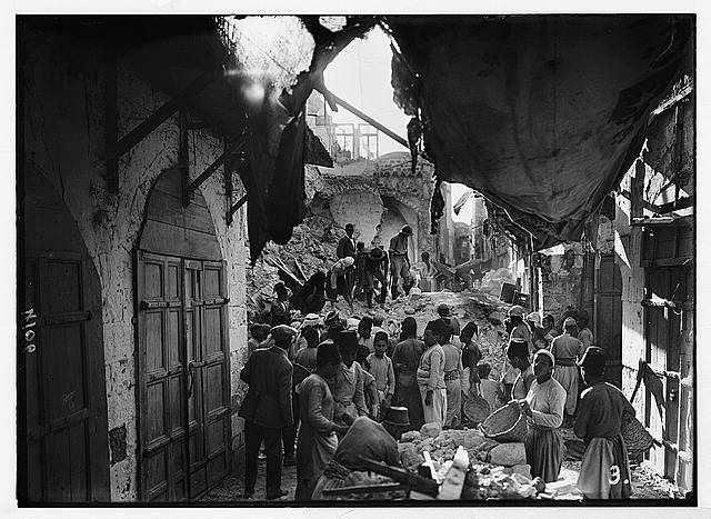 Palestine events. The earthquake of July 11, 1927. Blocked-up street in Nablus, choked by fallen houses which entombed many inhabitants