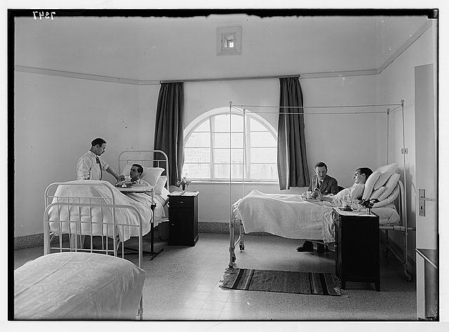 Scots Mission Hospital, Tiberias. Ward with two British soldiers with Dr. Torrance & Rev. Sloan.