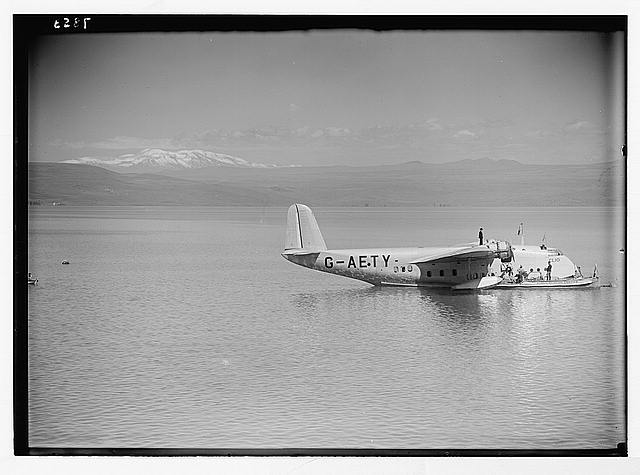 "Lido, flying boat Clio. Flying boat ""Clio"" on the lake with snow-capped Hermon"