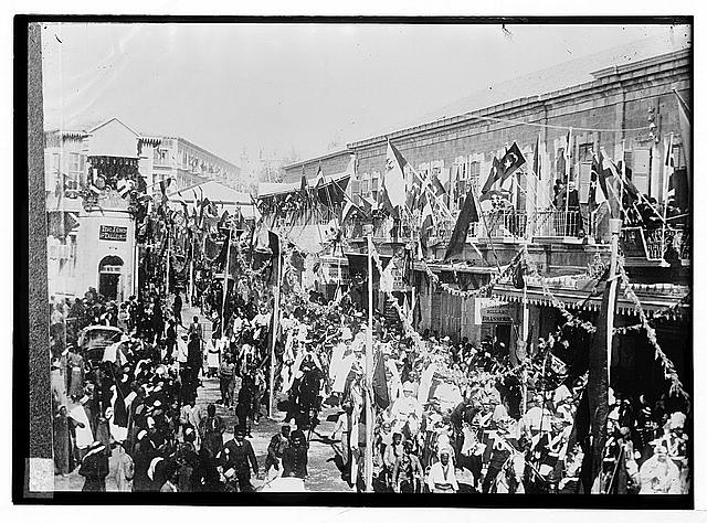 State visit to Jerusalem of Wilhelm II of Germany in 1898. General view of Jaffa Road, crowded with people and flags, during procession.