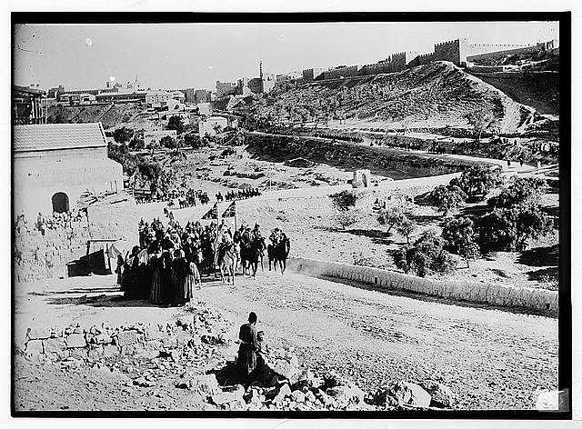 State visit to Jerusalem of Wilhelm II of Germany in 1898. Emperor riding with group; The Citadel, and west city wall are in background.